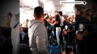 Cellphone video captured a brawl among five women on a cross-country Spirit Airlines flight after two women broke out a boom box and tried to get the plane rocking.NBC News screenshot