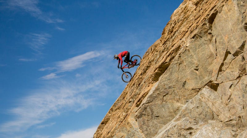 Illustration for article titled How To Make The World's Highest Road More Extreme: Mountain Bike It