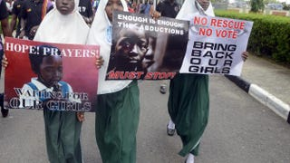 Pupils hold signs as members of Lagos-based civil-society groups hold rally calling for the release of missing Chibok schoolgirls at the state government house in Lagos, Nigeria, May 5, 2014.PIUS UTOMI EKPEI/AFP/Getty Images