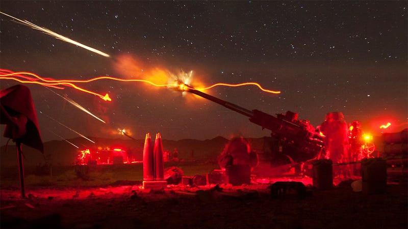 Illustration for article titled Check Out This Awesome Image of the US Marines Firing Artillery At Night