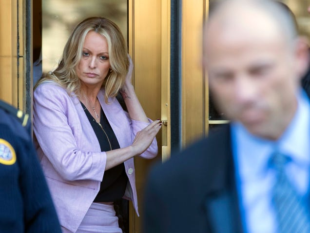 Adult-film actress Stormy Daniels follows her attorney, Michael Avenatti, as she leaves federal court on April 16, 2018, in New York City.