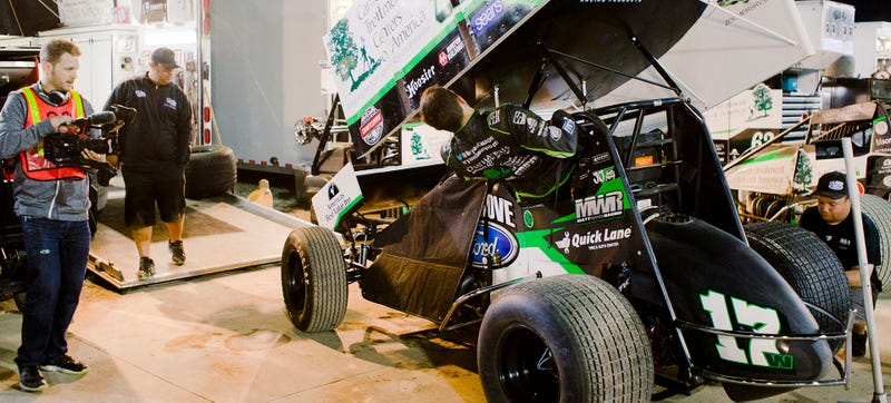 Clauson gets into his sprint car for his second feature race of the night, walking right from victory lane to get there. Photo Credit: Raphael Orlove