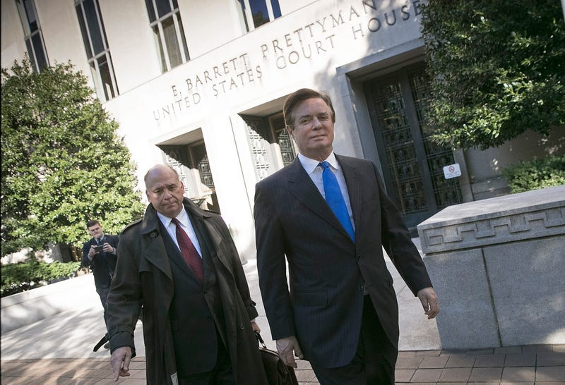 Former campaign manager for President Donald Trump, Paul Manafort (R), leaves U.S. District Court after pleading not guilty following his indictment on federal charges on October 30, 2017 in Washington, DC.