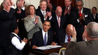 President Barack Obama is applauded after signing the Affordable Care Act on March 23, 2010, in the East Room of the White House.Win McNamee/Getty Images