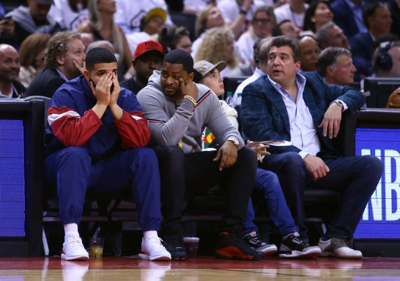 Drake (left) at Game 2 of the Eastern Conference semifinals between the Cleveland Cavaliers and the Toronto Raptors during the 2018 NBA Playoffs at Air Canada Centre on May 3, 2018, in Toronto