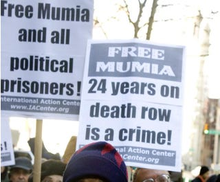 Supporters of inmate Mumia Abu-Jamal rally outside City Hall in Philadelphia Dec. 9, 2006. Jeff Fusco/Getty Images