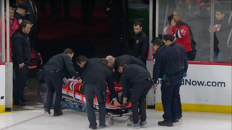 Illustration for article titled Devils' Mirco Mueller Taken Off On Stretcher After Crashing Into Boards