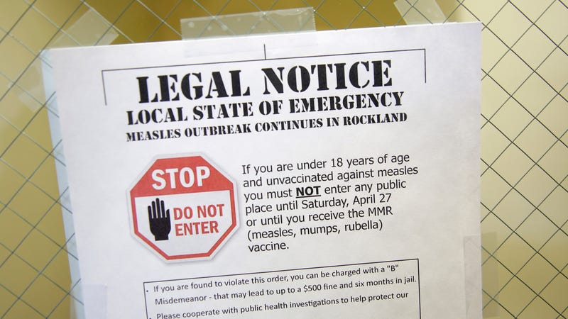 A sign explaining a recent state of emergency on display at the Rockland County Health Department in Pomona, New York on March 27, 2019.