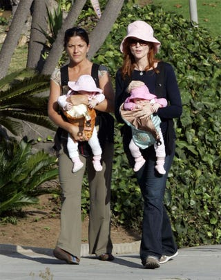 Illustration for article titled Marcia Cross Plays Pink-Lady Favorites With Her Twin Girls