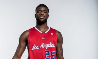 Reggie Bullock, No. 25 of the Los Angeles Clippers, poses for a portrait during the 2013 NBA rookie photo shoot at the MSG Training Center on Aug. 6, 2013, in Greenburgh, N.Y.Nick Laham/Getty Images