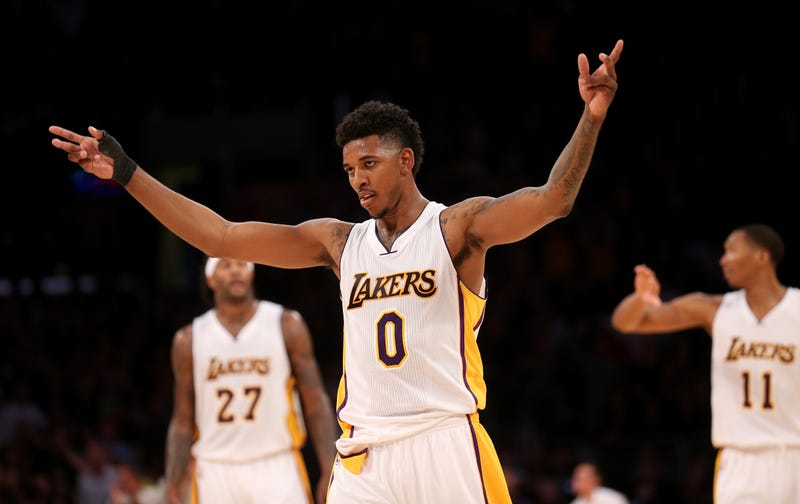 Nick Young, No. 0 of the Los Angeles Lakers, celebrates in the fourth quarter against the Toronto Raptors at Staples Center on Nov. 30, 2014, in Los Angeles.Stephen Dunn/Getty Images