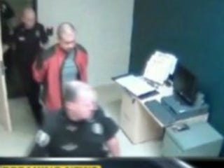 George Zimmerman and police officer (ABC News)