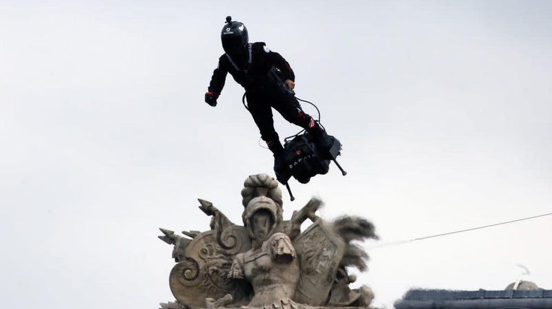 Illustration for article titled The French military is proud to unveil its very own hoverboard-riding, rifle-toting supervillain