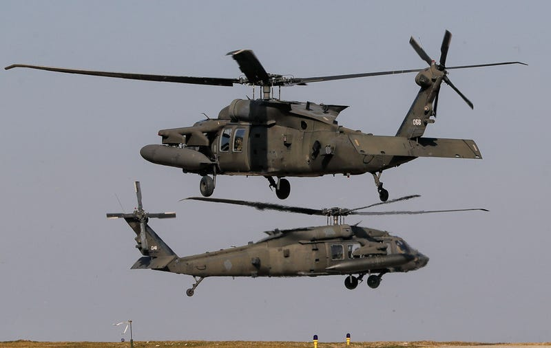 Blackhawk helicopters take off during a joint US-Romanian air assault exercise at the Mihail Kogalniceanu airbase, eastern Romania, Wednesday, March 8, 2017. (AP Photo/Vadim Ghirda)