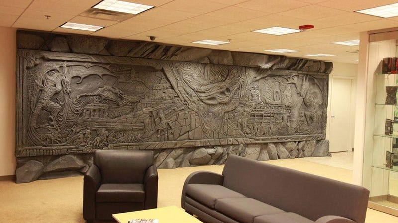 Illustration for article titled Skyrim's Giant Dragon Wall, Installed on a Regular Office Wall