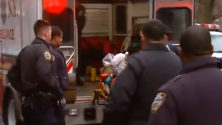 NYPD officer being loaded into an ambulance December 20, 2014Reuters screenshot