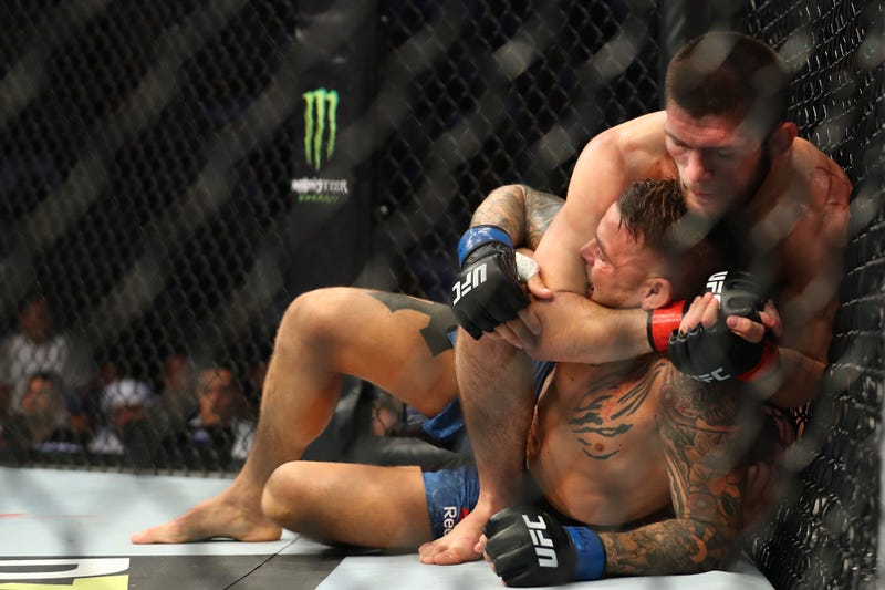 Illustration for article titled Khabib Nurmagomedov Remains Terrifyingly Good, Submits Dustin Poirier To Unify Lightweight Championship