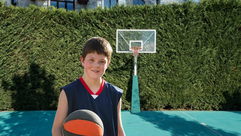 Illustration for article titled No Excuse: This Kid Who's Rich Enough To Have A Full-Blown Basketball Court In His Backyard Is By Far The Shittiest Basketball Player On His Team