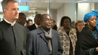 Zimbabwe President Robert Mugabe (center)