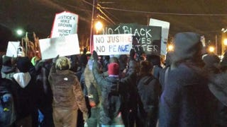 Protesters in Ferguson, Mo., on Nov. 25, 2014, respond to the St. Louis County grand jury decision not to indict Officer Darren Wilson in the killing of Michael Brown.Sharee Silerio/The Root