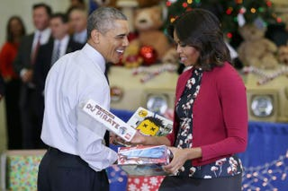 President Barack Obama and first lady Michelle Obama sort toys and gifts donated by Executive Office of the President staff to the Marine Corps Reserve Toys for Tots Program at Joint Base Anacostia-Bolling on Dec. 10, 2014, in Washington, D.C.Chip Somodevilla/Getty Images