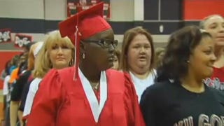 Lynzee Ford donned her cap and gown during a special graduation ceremony held in her honor on Oct. 20, 2014, by Kilgore High School in Texas days before she died of cancer. KLTV screenshot