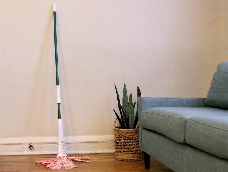Illustration for article titled Mop Used to Clean Minor Spill Now Permanent Addition to Living Room