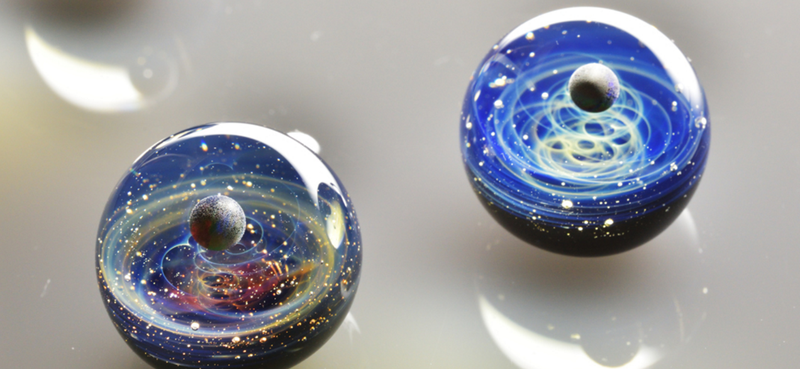 Illustration for article titled Become Master of Your Own Little Cosmos With a Space Glass Pendant
