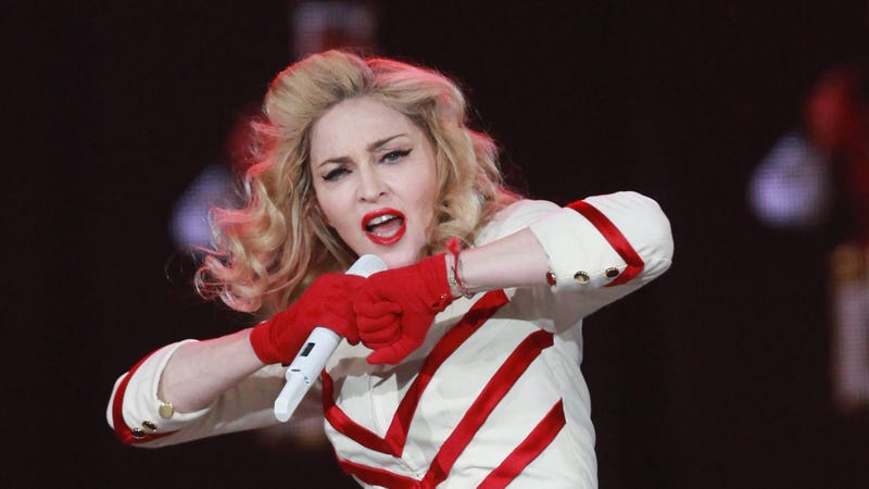 Illustration for article titled Is Madonna a Saintly Third-World School Builder or a Nefarious Self-Aggrandizing Lie-Monger?