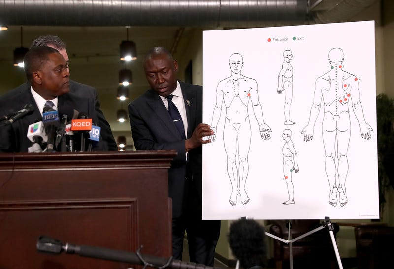 Attorney Ben Crump holds a diagram showing gunshot wounds to Stephon Clark during a news conference at the Southside Christian Center on March 30, 2018, in Sacramento, Calif.