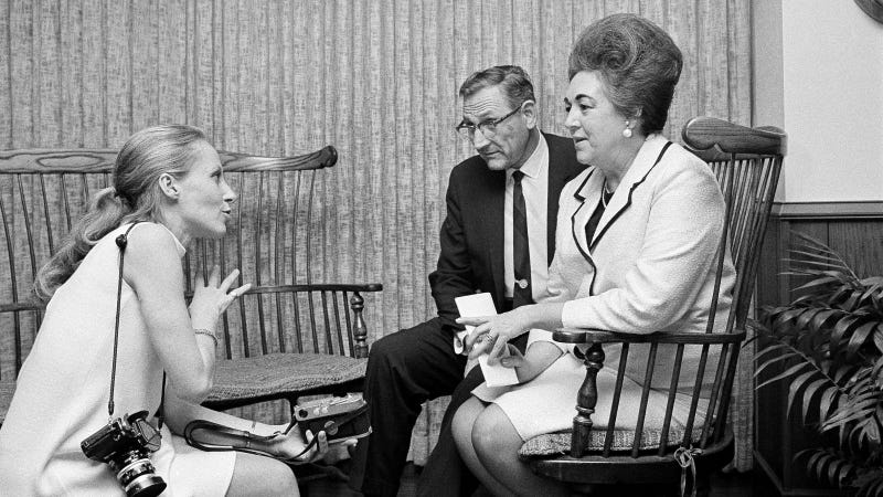 Famed Vietnam war photographer, Cathy Leroy, left, talks with Rep. Fred Schwengel (R-Iowa), and Jacqueline Day of Des Moines, Iowa, at San Francisco International Airport, Nov. 16, 1967. Mrs. Day will have Thanksgiving Day dinner with her son Marine Cpl. Tim Day at DaNang. Photo via AP Images.
