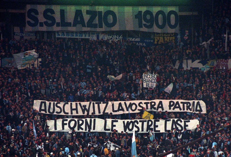 "A banner from Lazio supporters in 1998, referring to archrival AS Roma: ""Auschwitz is Your Homeland. The Ovens are Your Homes"""