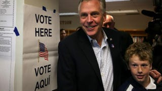 Democratic Virginia Gov. Terry McAuliffe and his son Peter leave a polling station after he casted his vote on Election Day, Nov. 5, 2013, in McLean, Va.Alex Wong/Getty Images