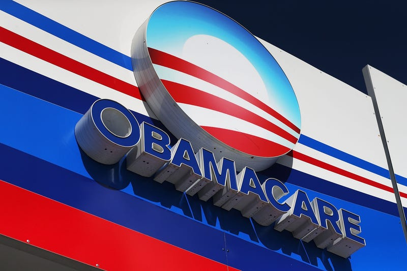 An Obamacare sign is seen on the UniVista Insurance company office Dec. 15, 2015, in Miami.Joe Raedle/Getty Images