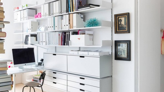 if you have a wall to spare a shelving system can make for a great custom workspace this one is filled with stuff but still manages to look bright and bright office