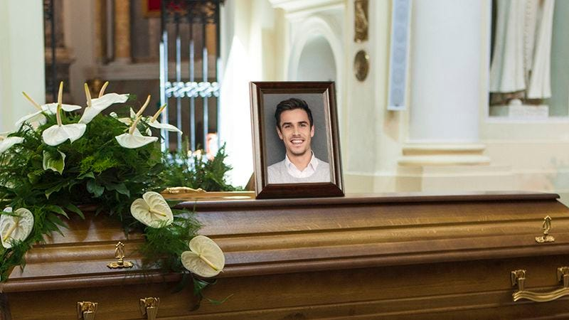 A coffin with a photo of an 18- to 34-year-old college-educated single white male making at least $70,000 per year.