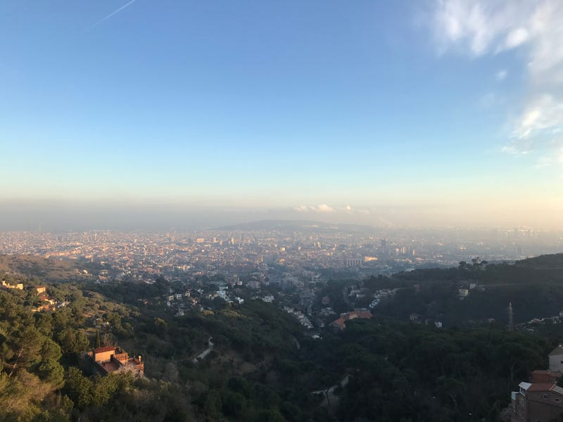 A view of Barcelona, showing the smog hanging over the city. Barcelona's city council has agreed to rid the city of high-polluting cars starting in 2020. Photo credit: Lucas Isakowitz
