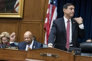 Rep. Darrell Issa motions to staff members to cut off the microphone of Rep. Elijah E. Cummings during a hearing of the House Oversight and Government Reform Committee, March 5, 2014.BRENDAN SMIALOWSKI/AFP/GETTY IMAGES