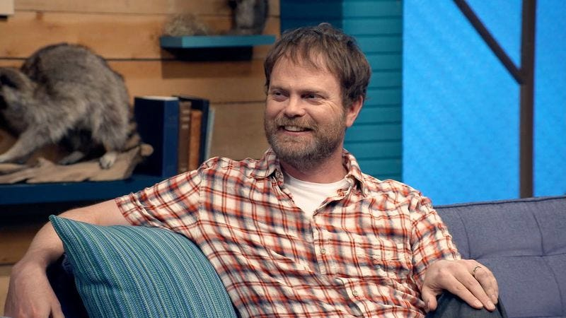 """Illustration for article titled Comedy Bang! Bang!: """"Rainn Wilson Wears A Short Sleeved Plaid Shirt & Colorful Sneakers"""""""