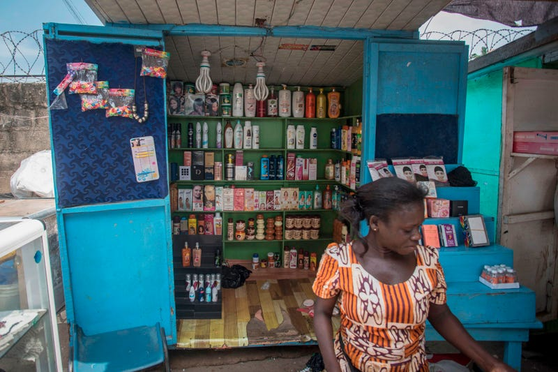 A shop sells skin-lightening products in Accra on July 3, 2018. Africa is experiencing a massive trend of skin bleaching, also called lightening or whitening, particularly in teenagers and young adults. The widening phenomenon is laden with health risks. In 2016, Government of Ghana banned hydroquinone, the main chemical component used in numerous skin-bleaching products, however, lots of different beauty brands are still promoting a lighter tone or a clarifying effect after its use.