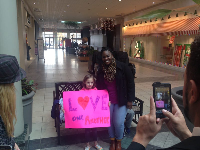 Kimberly Houzah poses with a supporter after a demonstration at the Quintard Mall in Oxford, Ala., on Dec. 8, 2016.AL.com screenshot