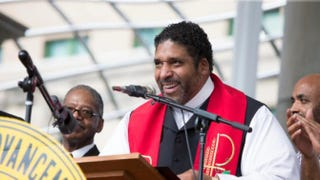 The Rev. William J. Barber II, president of the North Carolina NAACP, attends the Mountain Moral Monday 2014 event at Pack Square Park in Asheville, N.C., Aug. 4, 2014.Alicia Funderburk/Getty Images