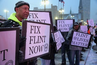 Demonstrators demand action about the water crisis in Flint, Mich., outside the  Fox Theater in Detroit before the GOP presidential debate March 3, 2016. (Chip Somodevilla/Getty Images)