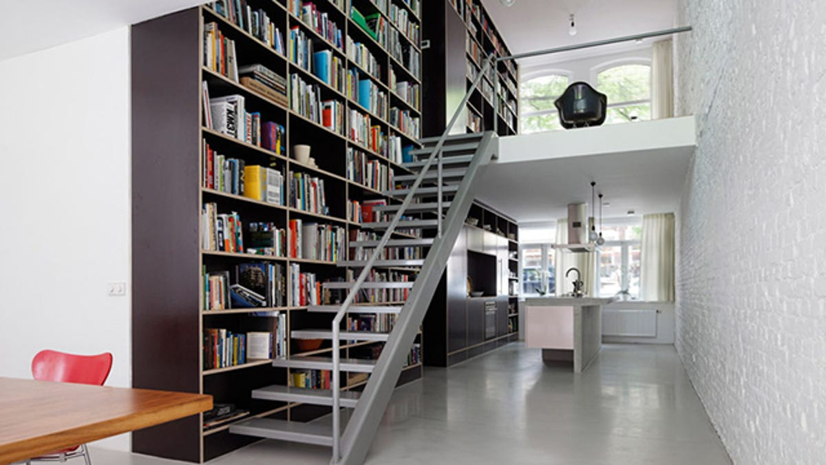 This Dream House Was Entirely Built Around A Giant Three Story High  Bookshelf