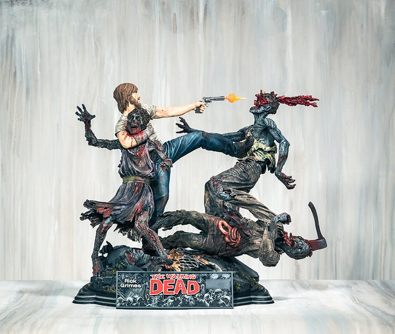 Illustration for article titled New Hyper-Violent The Walking Dead Statue