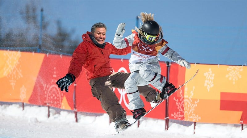 Chloe Kim and her father on a snowboard