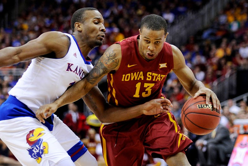 Bryce Dejean-Jones, No. 13, of the Iowa State Cyclones drives against Wayne Selden Jr. of the Kansas Jayhawks during the championship game of the Big 12 Basketball Tournament at Sprint Center on March 14, 2015, in Kansas City, Mo.Ed Zurga/Getty Images