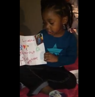 Londyn James holding up her note from Holland Cunningham in the Facebook videoTomeka Fisher via Facebook
