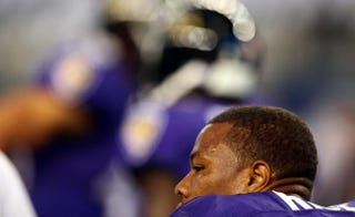 Ray Rice the Baltimore Ravens sits on the bench against the Dallas Cowboys in the first half of their preseason game at AT&T Stadium Aug. 16, 2014, in Arlington, Texas.Ronald Martinez/Getty Images