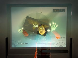 Illustration for article titled Turn Your Monitor Into a Touchscreen That Can Detect 16 Fingers, Using a Polymer Film